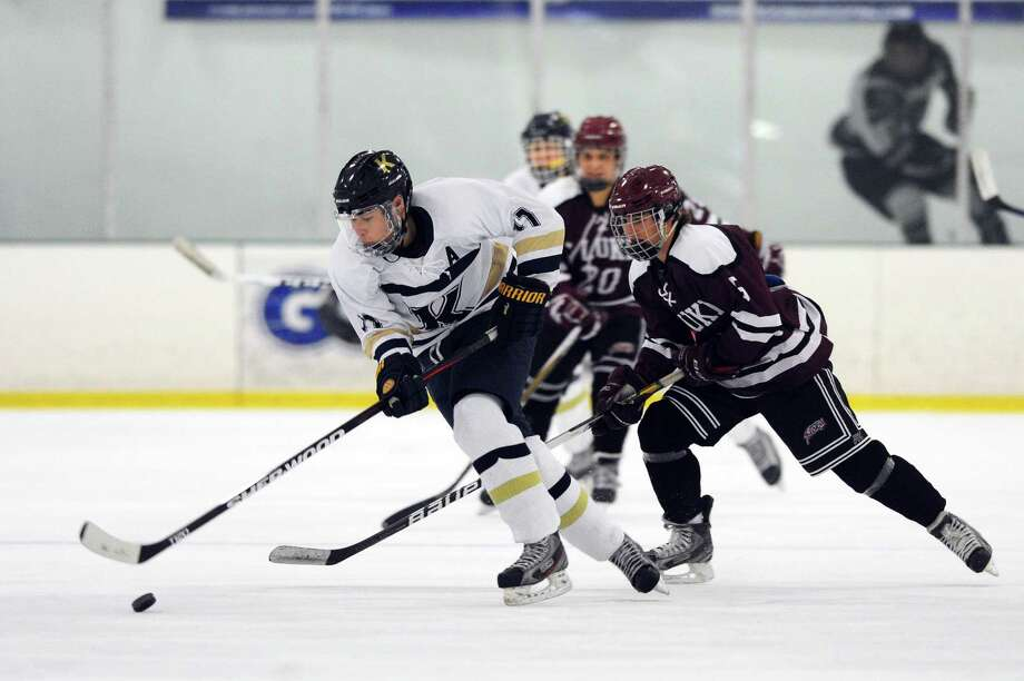 Richard Focke, of King School, outpaces David Ball, of St. Luke's, during the boys varsity hockey game at the SoNo Ice House in Norwalk, Conn. on Monday, Jan. 30, 2017. Photo: Michael Cummo / Hearst Connecticut Media / Stamford Advocate