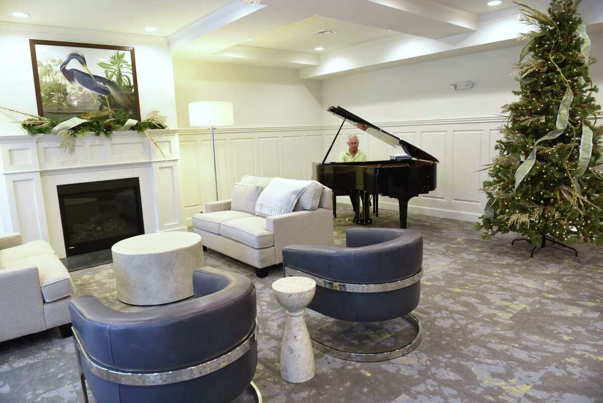 A piano and fireplace in the great room is seen during the grand opening of The Summit at Saratoga on Thursday, Dec. 1, 2016 in Saratoga Springs, N.Y. The Summit at Saratoga is a 110-unit senior independent living community for those 55 and older. (Lori Van Buren / Times Union)