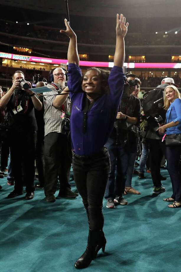 US Olympic gold medalist Simone Biles performs during Super Bowl 51 Opening Night at Minute Maid Park on January 30, 2017 in Houston, Texas. Photo: Tim Warner, Getty Images / 2017 Getty Images