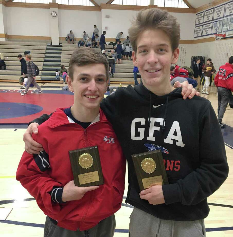 Greens Farms Academy wrestlers Sam Stuart, left, a junior from Westport, and Hans Forland, a senoir from Wilton, both won Fairchester Athletic Association wrestling championships on Saturday at the FAA championship meet at Coyle Gym in Westport. Stuart won his second straight 106-pound title while Forland won his fourth league title, this time at 120 pounds. Photo: John Nash