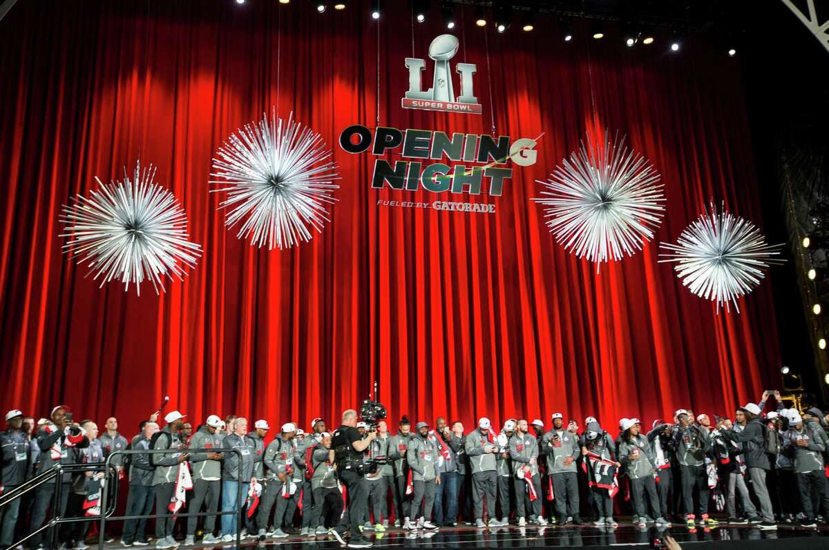 Atlanta Falcons players stand on the stage as they are introduced during Super Bowl LI Opening Night at Minute Maid Park on Monday, Jan. 30, 2017, in Houston.