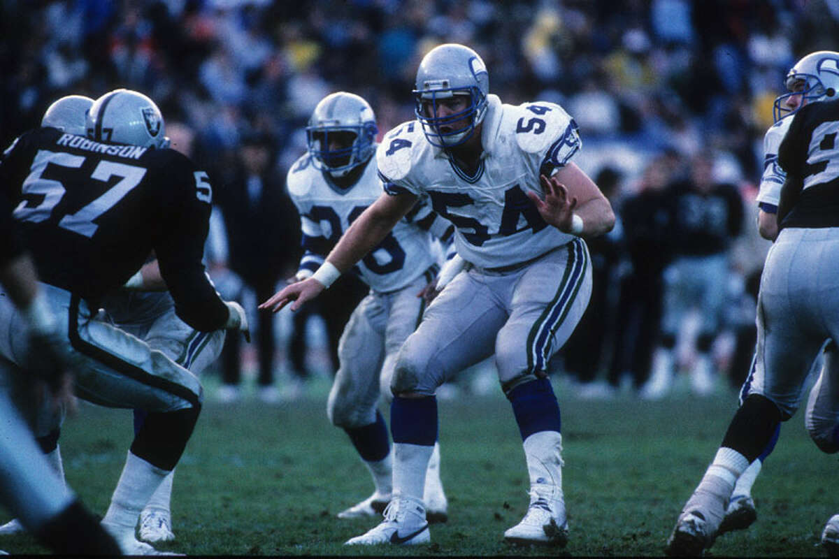 After leaving Abilene Christian University, Grant Feasel (54) played eight seasons as a center in the NFL, spending the final six with the Seahawks.