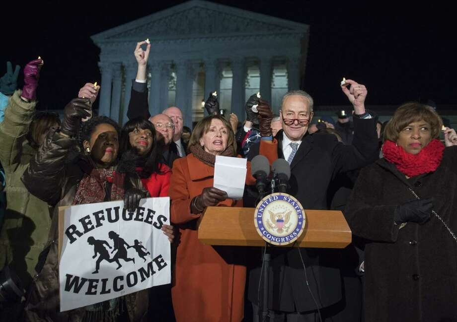Senate Minority Leader Chuck Schumer (2nd R), Democrat of New York, US House Democratic Leader Nancy Pelosi (C), speak alongside other members of Congress as demonstrators protest against US President Donald Trump and his administration's ban of travelers from 7 countries by Executive Order, during a rally outside the US Supreme Court in Washington, DC, on January 30, 2017. Trump's executive order suspended the arrival of all refugees for at least 120 days, Syrian refugees indefinitely -- and bars citizens from Iran, Iraq, Libya, Somalia, Sudan, Syria and Yemen for 90 days.  Protests are taking place at airports across the country in opposition to the ban. / AFP PHOTO / SAUL LOEBSAUL LOEB/AFP/Getty Images Photo: SAUL LOEB / AFP or licensors