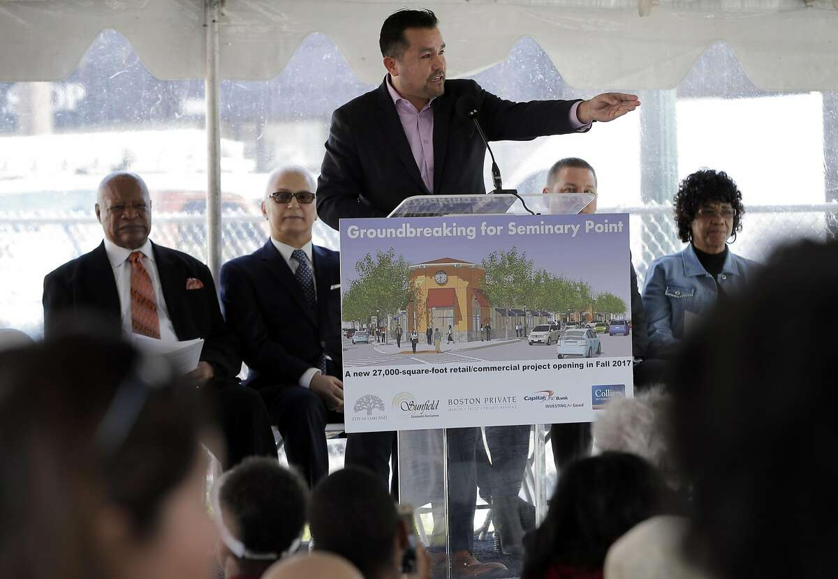 Jose Corona, the Director of Equity and Strategic Partnerships with Mayor Libby Shaaf's office, speaks to the crowd during a groundbreaking ceremony for Seminary Point, a public private partnership at Seminary Avenue and Foothill Blvd., that's been in the works for years in Oakland, Calif., on Monday, January 30, 2017. The retail center will bring much needed shopping options to east Oakland.