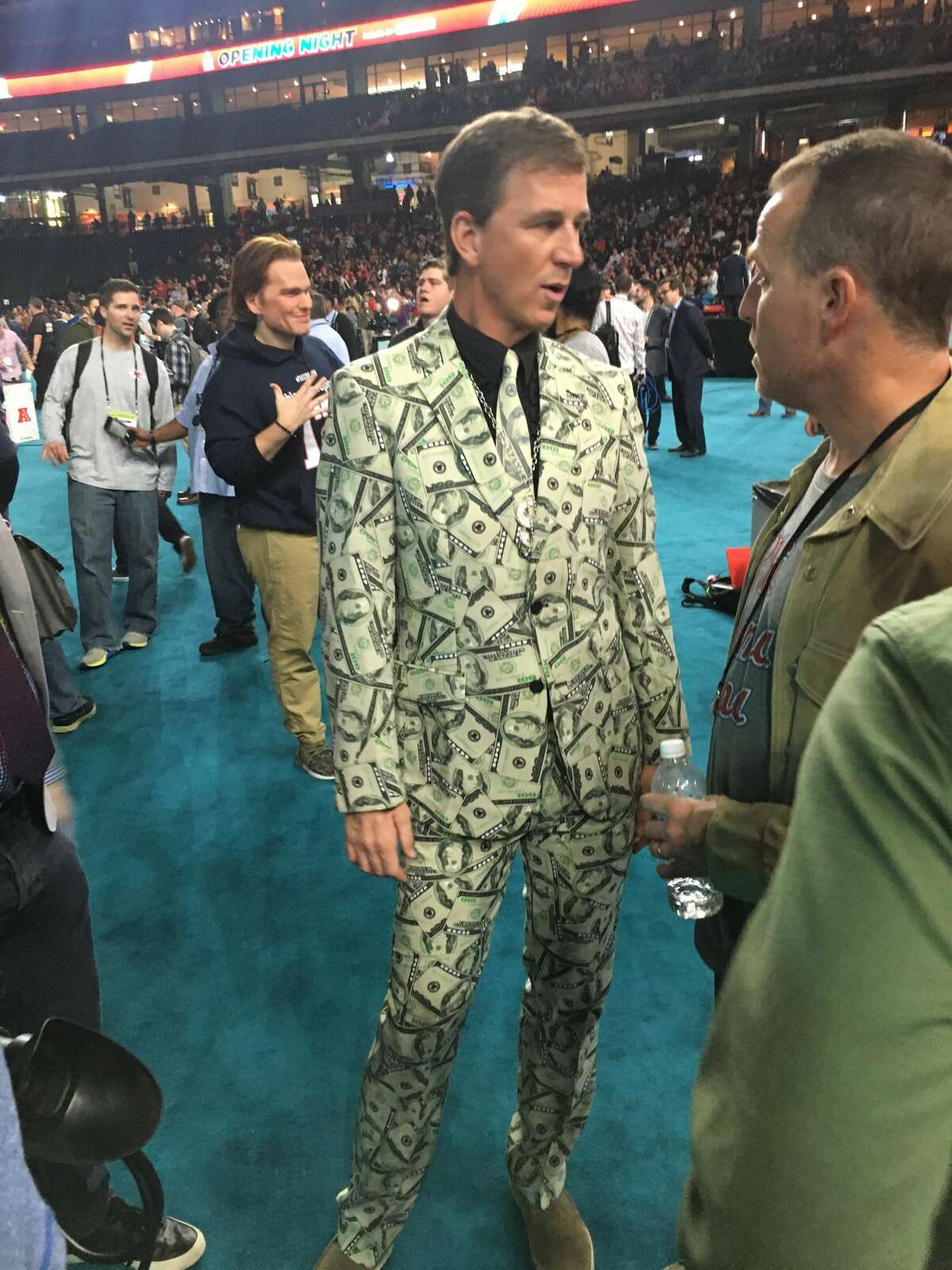 Cooper Manning's suit was money The sharpest dressed man was Cooper Manning, older brother of Peyton and Eli Manning. The guy was wearing a suit covered in the design of $100 bills complete with a matching tie. Cooper Manning is the coolest Manning.