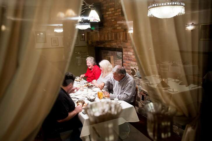 Patrons eat in a private room at Stanley's Steakhouse in Jackson, Calif., on Sunday, Jan. 29, 2017.