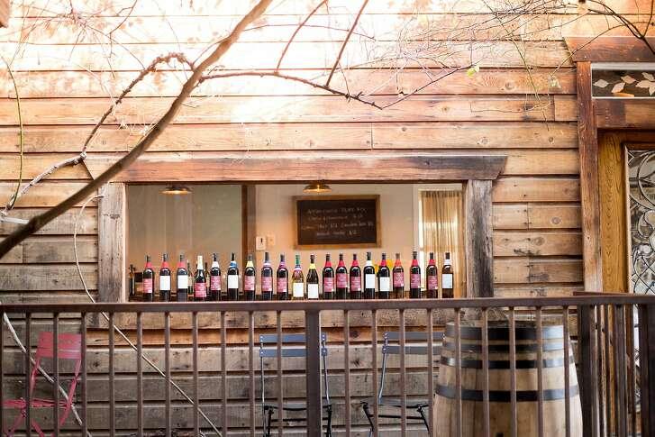 Wine bottles line a window at Feist Wines in Sutter Creek, Calif., on Saturday, Jan. 28, 2017.
