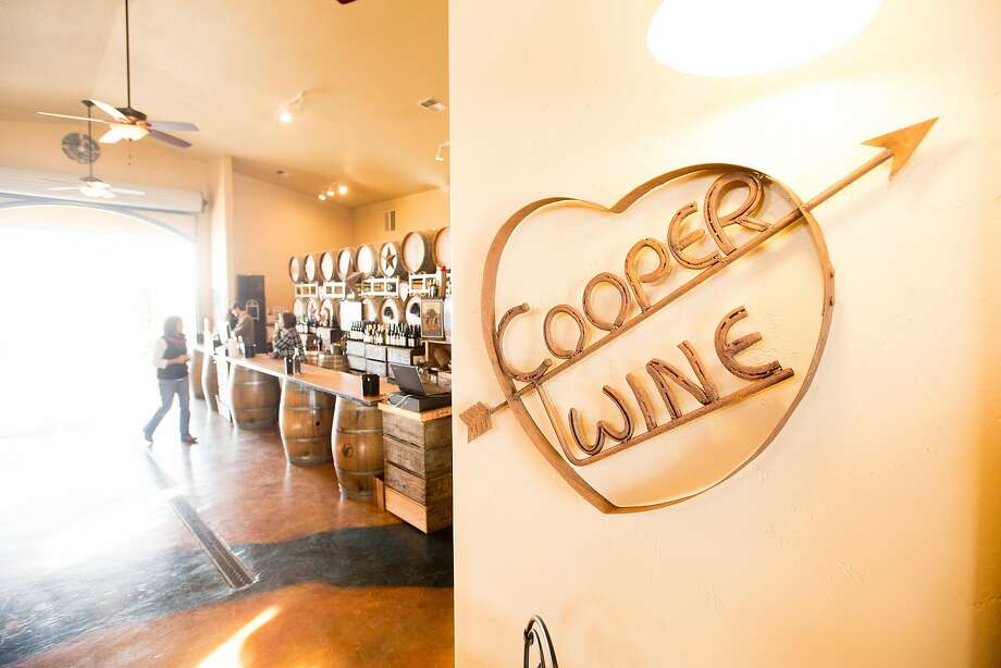 A sign points the way at the tasting room at Cooper Vineyards. Photo: Noah Berger, Special To The Chronicle