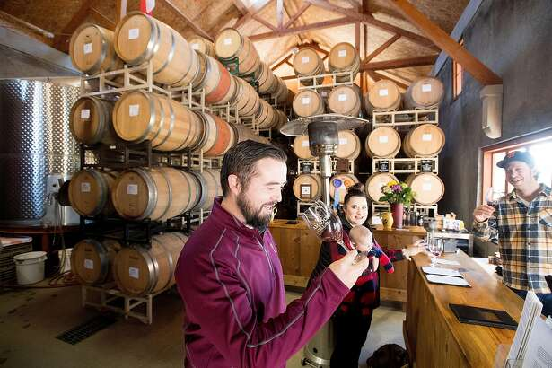 Maclain Atkinson tastes wine at Amador Cellars in Plymouth, Calif., on Saturday, Jan. 28, 2017. At right is winemaker Michael Long.
