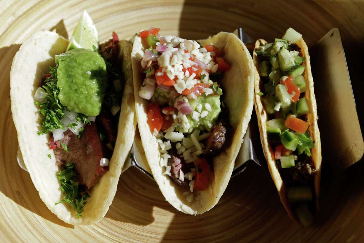 A smoked brisket taco, left, Tex-Mex Angus steak taco, center, and lamb keema taco are shown at Fusion Taco, 4706 N. Main.