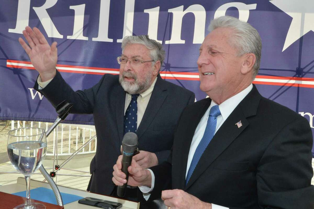 Former Mayor Alex Knopp joins Mayor Harry Rilling as he announces his run for a third term during a re-election announcement at the Norwalk Inn and Conference Center on Sunday.