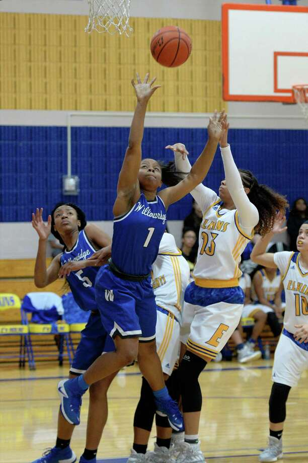 Kennethia Gilford (1) of Willowridge attempts a shot during the first half of a girls basketball game between the Elkins Knights and the Willowridge Eagles on Tuesday January 24, 2017 at Elkins High School, Missouri City, TX. Photo: Craig Moseley, Staff / ©2016 Houston Chronicle