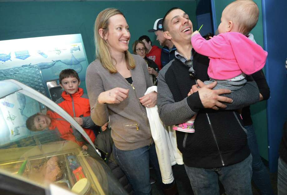 Bethel's Marco Rodriques gets a tase of gelato with wife Colleen and daughter Lianna at Screme Gelato Bar during Chocolate Expo on Sunday at The Maritime Aquarium in Norwalk Conn. About 40 local and regional vendors, including top area chocolatiers filled the Aquarium galleries, offering samples and sales of their gourmet chocolates, baked goods and specialty foods. Photo: Alex Von Kleydorff / Hearst Connecticut Media / Connecticut Post