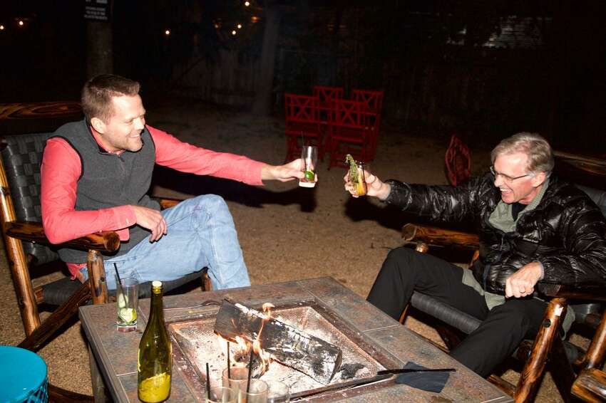 Jon Carlson and Tim Clarke are having a drink by the fire at The Bin. Photo By: Xelina Flores
