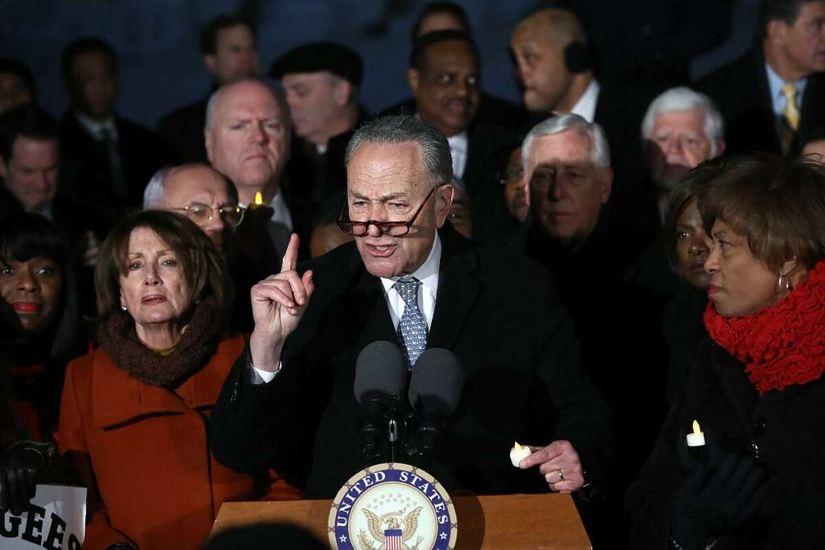 Senate Minority Leader Chuck Schumer (D-NY) and House Minority Leader Nancy Pelosi (D-CA) lead members of Congress during a protest on the steps of the U.S. Supreme Court January 30, 2017 in Washington, DC. Members of Congress joined refugees, immigrants and members of the Washington DC community in protesting the Trump administration's recent executive order banning immigration from seven predominantly Muslim countries.