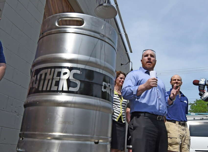 Chris Martell, owner Druthers Brewing Company, speaks during the opening for Druthers Brewing Company's new establishment on Broadway Tuesday, May 26, 2015, in Albany, N.Y. This their third location in the region. (Skip Dickstein/Times Union)