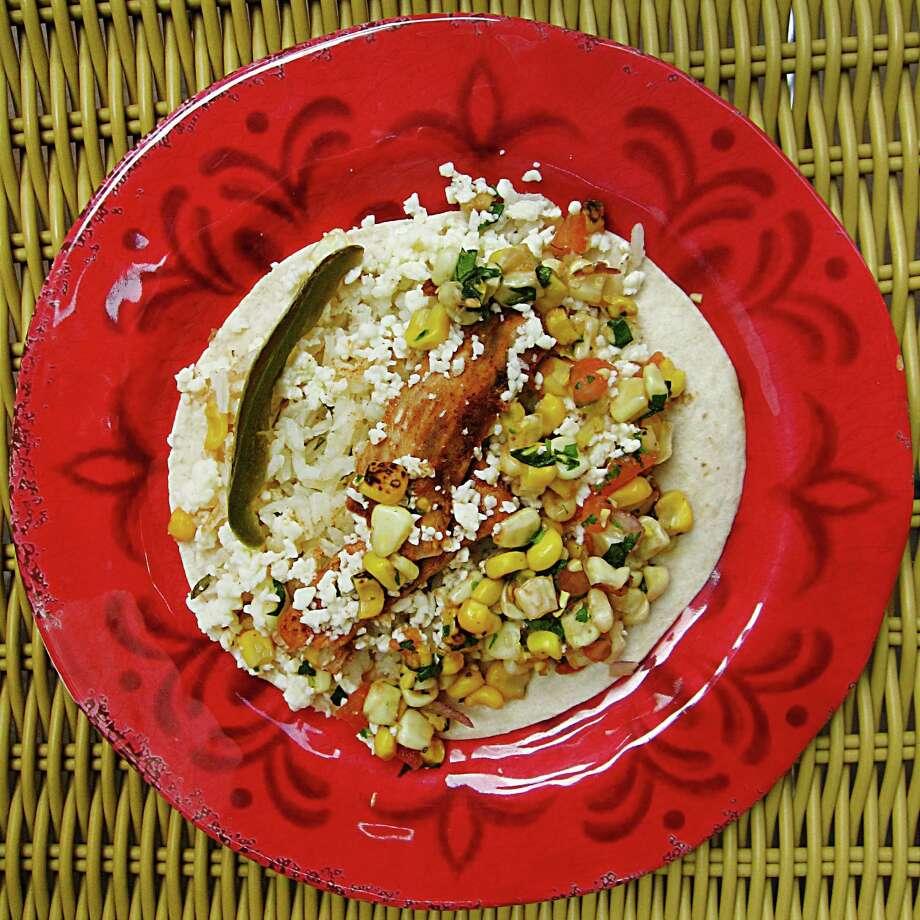 Mahi mahi taco with corn relish, cotija cheese and cilantro-lime rice from Zócalo. Photo: Mike Sutter /San Antonio Express-News