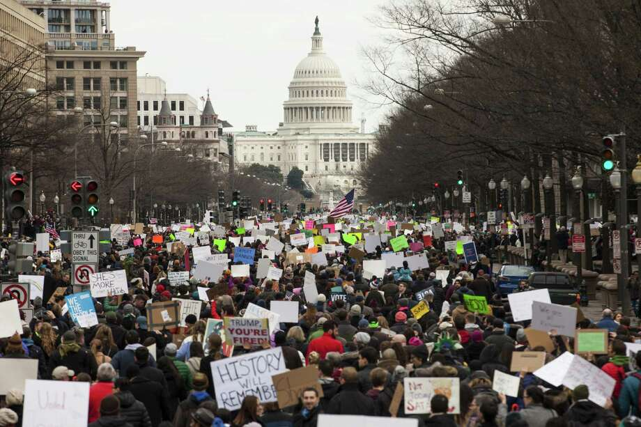 WASHINGTON, DC - JANUARY 29: Demonstrators march down Pennsylvania Avenue during a protest on January 29, 2017 in Washington, DC. Protestors in Washington and around the country gathered to protest President Donald Trump's executive order barring the citizens of Muslim-majority countries Iraq, Syria, Iran, Sudan, Libya, Somalia and Yemen from traveling to the United States.  (Photo by Zach Gibson/Getty Images) Photo: Zach Gibson, Stringer / Getty Images / 2017 Getty Images