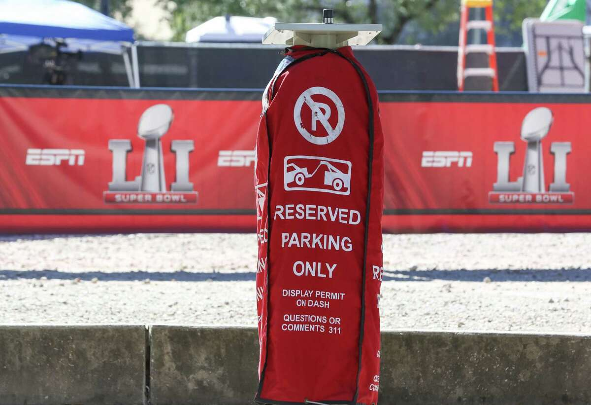 Some public street parking spaces are reserved for Super Bowl parking pass holders near Discovery Green, seen on Jan. 30. Many road closures and blockages, and parking restrictions are enforced in downtown area due to Super Bowl LI activities and events.
