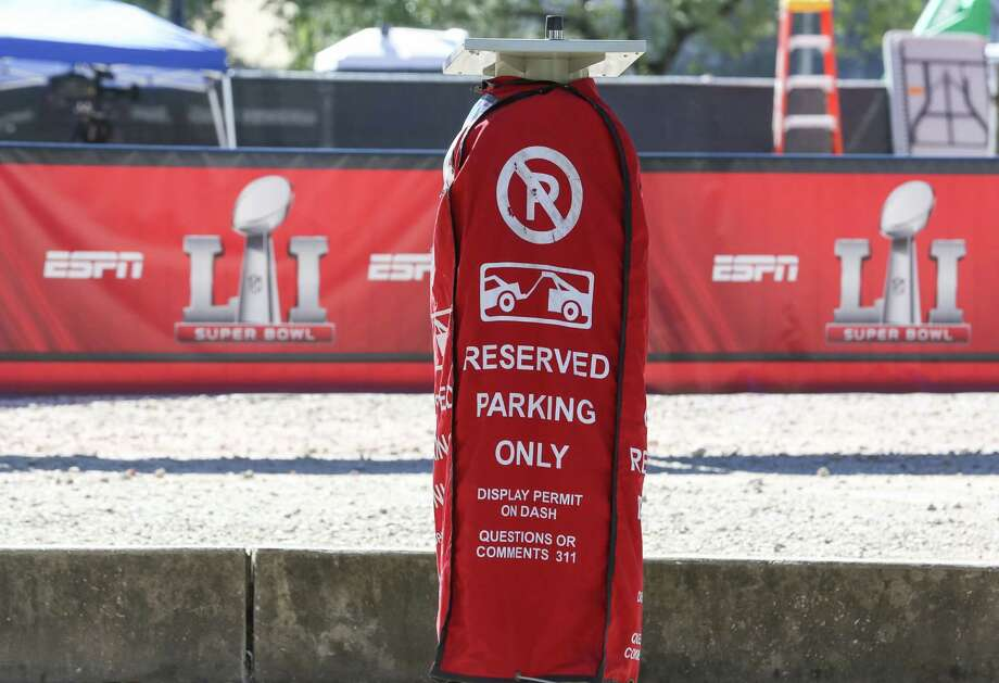 Some public street parking spaces are reserved for Super Bowl parking pass holders near Discovery Green, seen on Jan. 30. Many road closures and blockages, and parking restrictions are enforced in downtown area due to Super Bowl  LI activities and events. Photo: Yi-Chin Lee / Houston Chronicle, Houston Chronicle / Houston Chronicle 2017