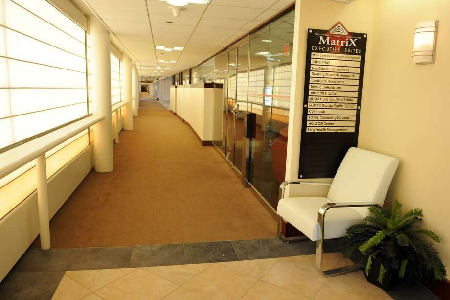 An interior hallway at the Matrix Corporate Center, in Danbury, Conn. July 1, 2014. Photo: Ned Gerard / Ned Gerard / Connecticut Post