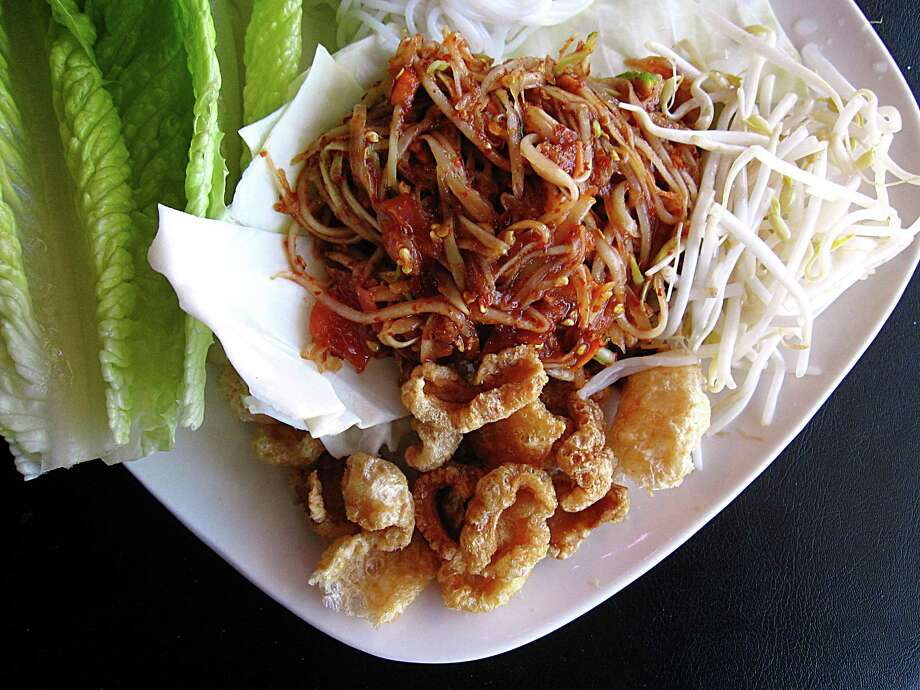 Spicy papaya salad with romaine lettuce, white noodles, bean sprouts and chicharrones from Thai Lucky, a new restaurant on South Pine Street. Photo: Mike Sutter /San Antonio Express-News