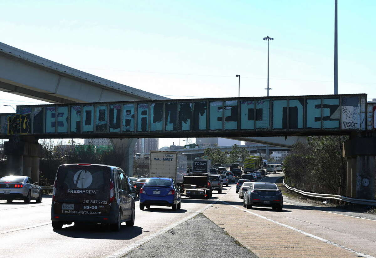 """The famous """"Be Someone"""" graffiti bridge has been changed to """"Football"""" Tuesday, Jan. 31, 2017, in Houston."""