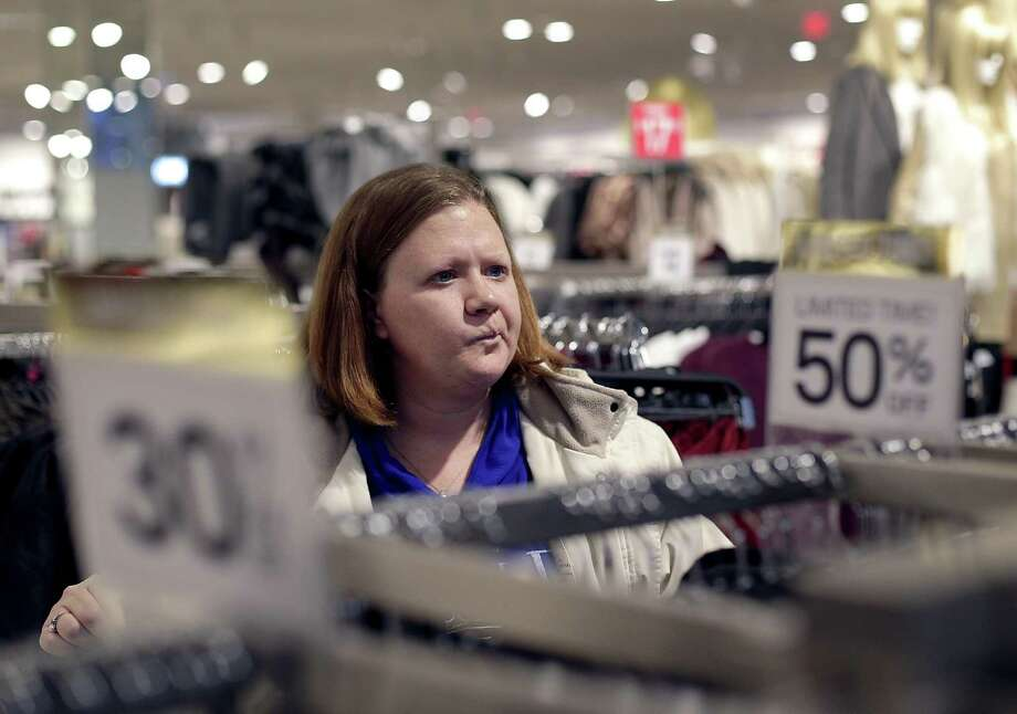 The Conference Board reported Tuesday its consumer confidence index slipped to 111.8 in January from a December reading of 113.3, which had been the highest since August 2001. Photo: Associated Press /File Photo / Copyright 2016 The Associated Press. All rights reserved.