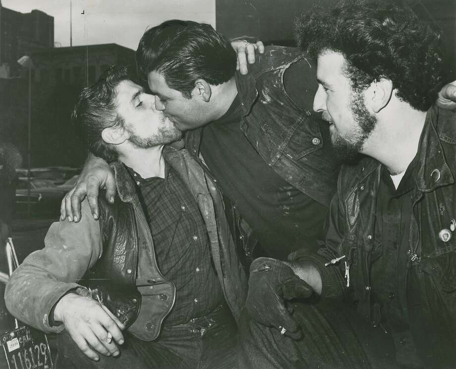 "November 30,  1964: Hells Angels kissing. Big man on the right is ""Puff."" The caption for this photo, that appeared in the Chronicle, read as follows: ""We're 'kiss-me, baby' angels from hell and here's a smack to prove it."" Photo: Peter Breinig, San Francisco Chronicle"
