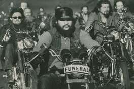 """January 15,  1977: """"Outlaw motorcyclists"""" in cortege for """"Harry the Horse"""" Flamburis, on Dolores Street in San Francisco."""
