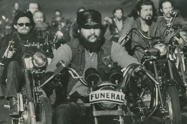 "January 15,  1977: ""Outlaw motorcyclists"" in cortege for ""Harry the Horse"" Flamburis, on Dolores Street in San Francisco."