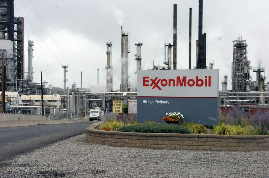 Exxon's $2 billion writedown on its Rocky Mountain fields slashed fourth-quarter profit to $1.68 billion, compared with $2.78 billion a year earlier, the Irving-based oil producer said. It was smallest quarterly gain since it earned $1.53 billion in the third quarter of 1999. Photo: Matt Brown /Associated Press / Copyright 2016 The Associated Press. All rights reserved.