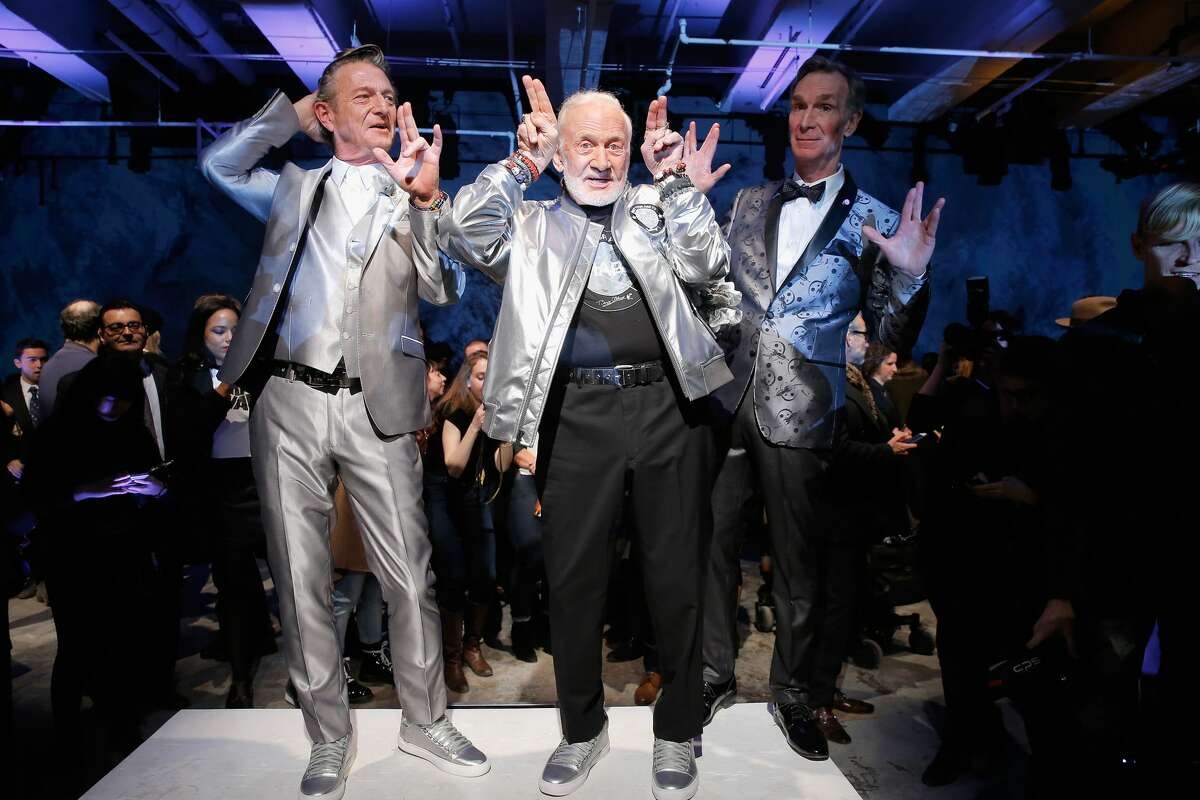 >>Keep clicking to see more photos of Bill Nye the Science Guy and former astronaut Buzz Aldrin as they vogue down the runway in Nick Graham's fashion show titled,