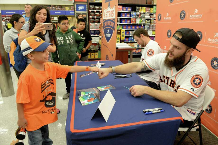 Astros pitcher Dallas Keuchel fist bumps Issac Flores (Age 8) of Katy during a stop of the 2017 Astros Caravan at the Academy Sports & Outdoors in Katy.Click through the gallery for more photos from past Astros Caravan stops. Photo: Craig Moseley, Staff / ©2017 Houston Chronicle