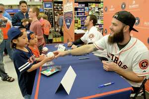 Dallas Keuchel and Brady Rodgers sign autographs for Houston residents Misaki Nakamura (Age 9) and his brother Daisuke (Age 5) during a stop of the 2017 Astros Caravan at the Academy Sports & Outdoors in Katy, TX on Wednesday January 18, 2017.