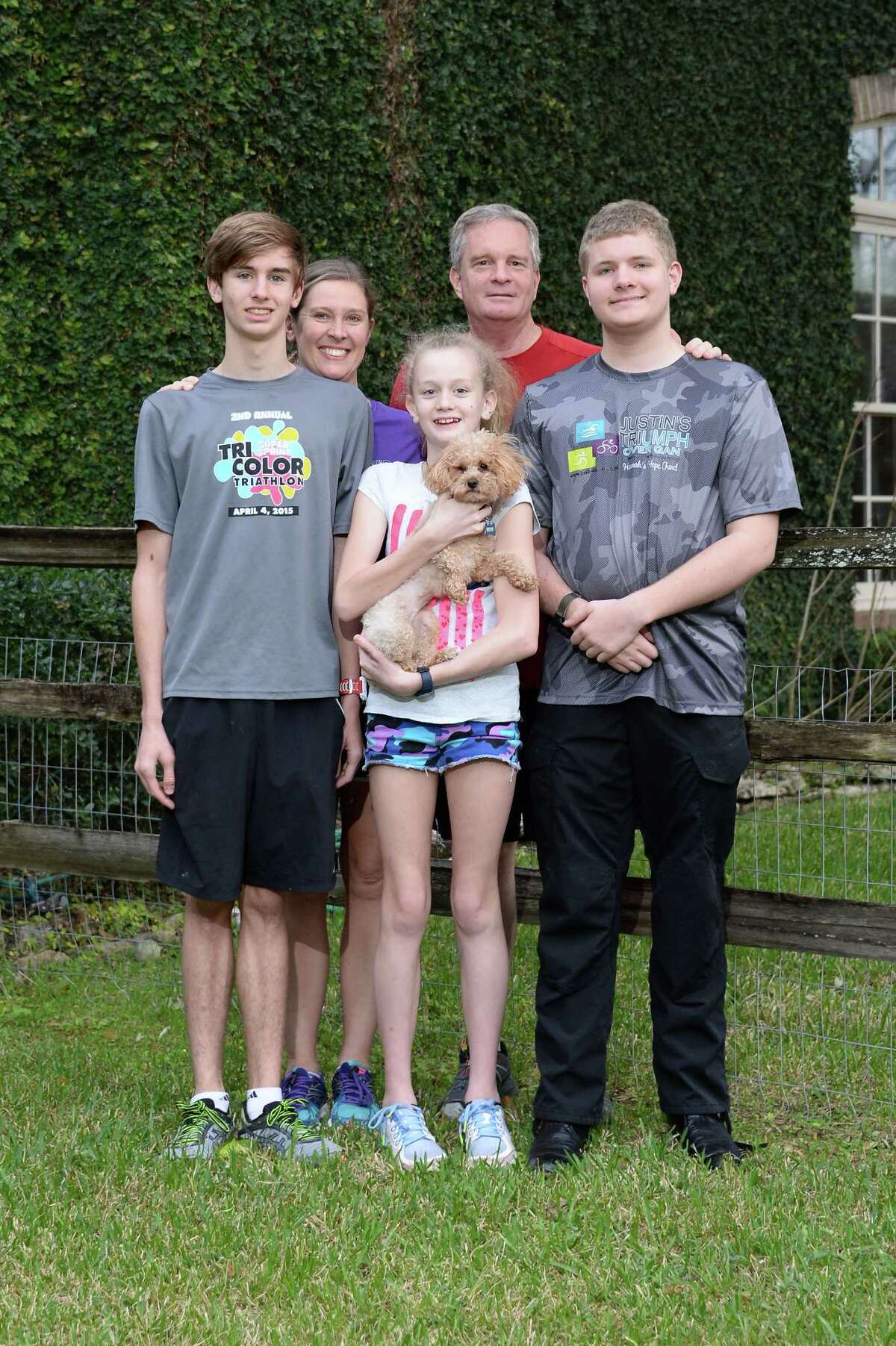 The Clark Family outside their home in Bellaire, TX on Wednesday January 25, 2017. Pictured are (L-R) Jared, Lagenia, Lexi, David and Justin Clark.