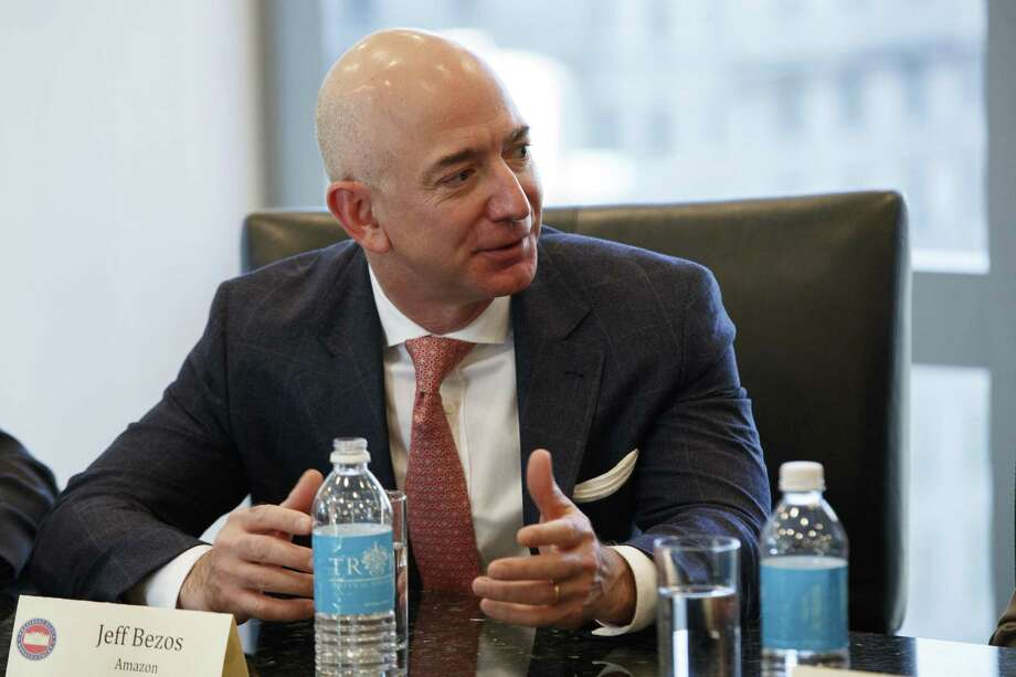 Amazon founder and CEO Jeff Bezos says the Seattle-based company supports a lawsuit filed by Washington state's attorney general against President Donald Trump and the administration over Trump's executive order on immigration and refugees. Washington state-based companies Microsoft and Expedia are also supporting the suit. Photo: Evan Vucci /Associated Press / Copyright 2016 The Associated Press. All rights reserved.