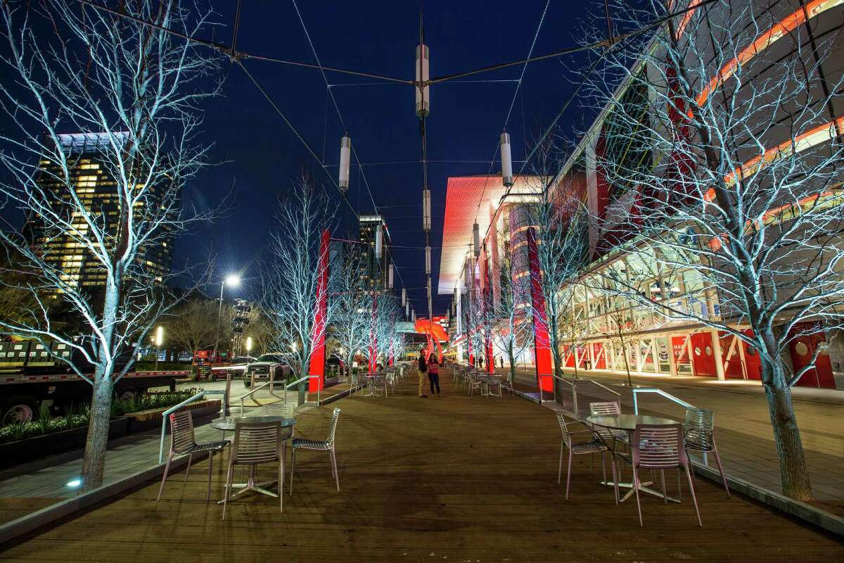 Tables and chairs are found in the garden and wharf areas of the Avenida Houston civic plaza.