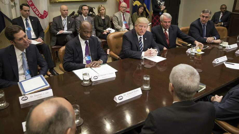 President Donald Trump meets with pharmaceutical company executives Tuesday in the Roosevelt Room of the White House. From left: Stephen Ubl, chief executive of PhRMA; Kenneth Frazier, chief executive of Merck & Co.; Trump; Robert Hugin, chief executive of Celgene; and Robert Bradway, chief executive of Amgen. Photo: Stephen Crowley /New York Times / NYTNS