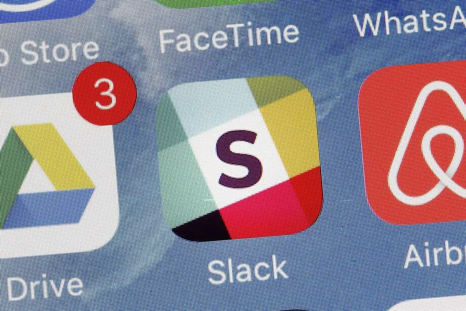 Slack's app is displayed on a mobile phone, but it also works on a variety of computers. Photo: Mark Lennihan, Associated Press
