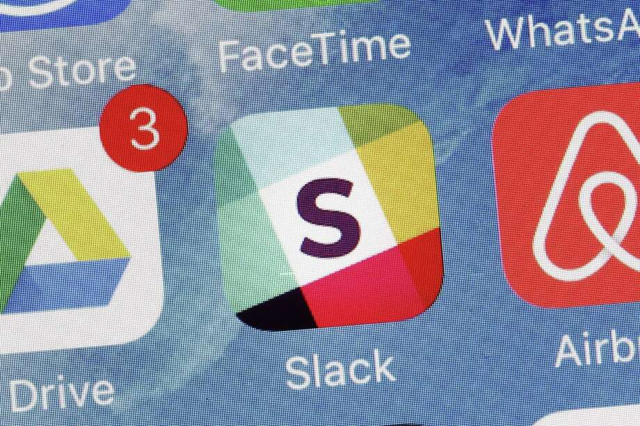 Slack Technologies is hoping to convert more big businesses to its online business messaging service by making it easier for workers in different departments to communicate with each other. Photo: Mark Lennihan /Associated Press / Copyright 2017 The Associated Press. All rights reserved.