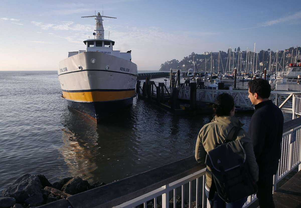The Blue & Gold Fleet's Royal Star docks at Zelinsky Landing in Tiburon, Calif. to ferry passengers to San Francisco on Tuesday, Jan. 31, 2017. Golden Gate Ferry was scheduled to take over the Tiburon to San Francisco morning and afternoon commuter routes from the Blue & Gold Fleet this week but safety concerns raised by the Angel Island Tiburon Ferry Company, which also uses the same marina, has delayed the transition.