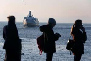 Commuters wait in line to board the Blue & Gold Fleet's Royal Star ferry as it arrives at Zelinsky Landing in Tiburon, Calif. on Tuesday, Jan. 31, 2017. Golden Gate Ferry was scheduled to take over the Tiburon to San Francisco morning and afternoon commuter routes from the Blue & Gold Fleet this week but safety concerns raised by the Angel Island Tiburon Ferry Company, which also uses the same marina, has delayed the transition.