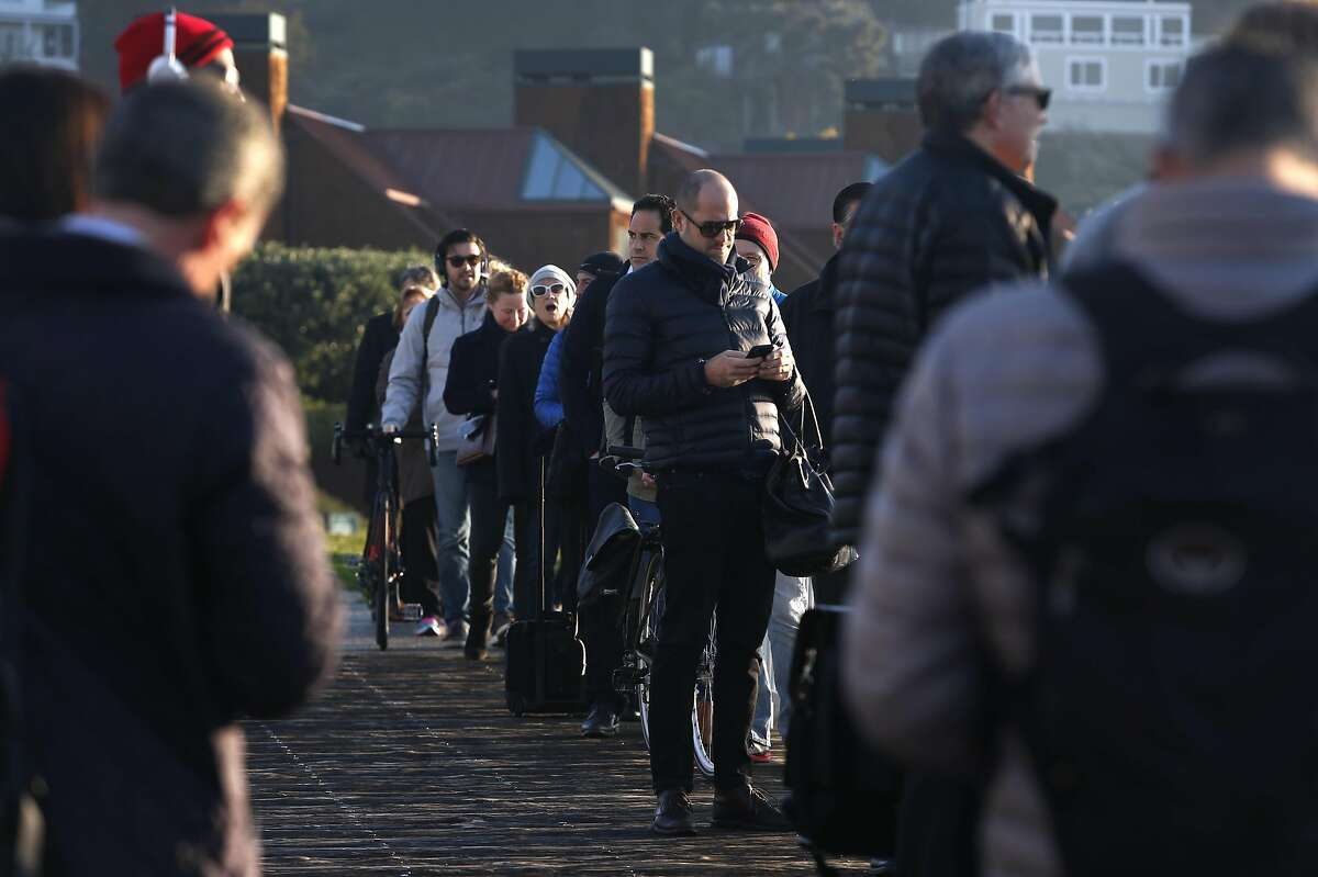 Commuters in line wait to board the Blue & Gold Fleet's Royal Star ferry at Zelinsky Landing in Tiburon, Calif. on Tuesday, Jan. 31, 2017. Golden Gate Ferry was scheduled to take over the Tiburon to San Francisco morning and afternoon commuter routes from the Blue & Gold Fleet this week but safety concerns raised by the Angel Island Tiburon Ferry Company, which also uses the same marina, has delayed the transition.