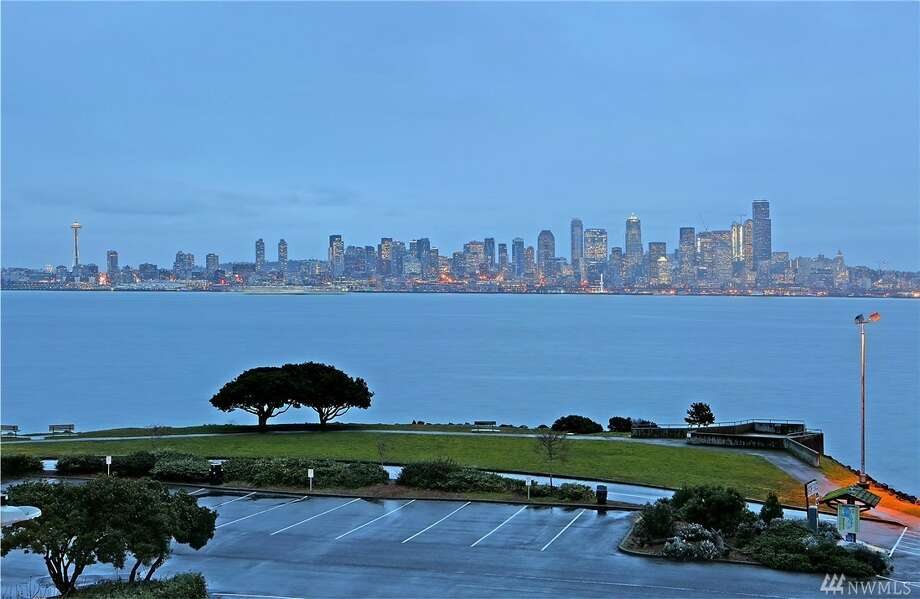 1205 Harbor Ave. S.W. See the full listing here.This is a modern townhouse, with magnificent views of the city and Elliott Bay (available from every floor). In addition to a two-car garage, a private elevator, and a chef's kitchen, there's also a rooftop deck to take in the sights. Photo: Listing Provided Courtesy Of Randie Stone, Windermere R.E.