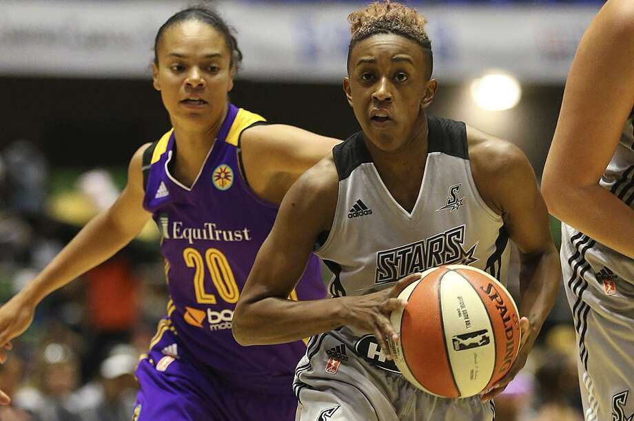 Stars' Danielle Robinson drives the ball as the Los Angeles Sparks' Kristi Toliver chases her during the first half at Freeman Coliseum on Aug. 23, 2015. Photo: Jerry Lara /San Antonio Express-News / © 2015 San Antonio Express-News