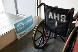 A sign for enrollment in Covered California is seen next to a wheelchair in the Asian Health Services offices on the final day of open enrollment for Covered California, the state's health insurance marketplace created by the Affordable Care Act, in Oakland, CA on Tuesday, January 31, 2017.