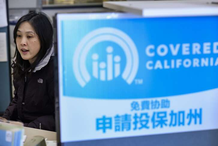 Member services representative Nancy Chen helps a customer with their coverage at the Asian Health Services offices on the final day of open enrollment for Covered California, the state's health insurance marketplace created by the Affordable Care Act, in Oakland, CA on Tuesday, January 31, 2017.