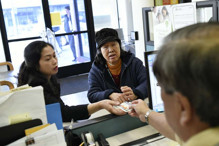 Customers Minh Nguyen, left, and her mother Mui Vong get help form Member services representative Wayee Thieu at the Asian Health Services offices on the final day of open enrollment in 2017 for Covered California, the state's health insurance marketplace created by the Affordable Care Act. The percentage of Californians without health insurance fell to a record low 7.1 percent in 2016, according to a CDC estimate. Photo: Michael Short, Special To The Chronicle