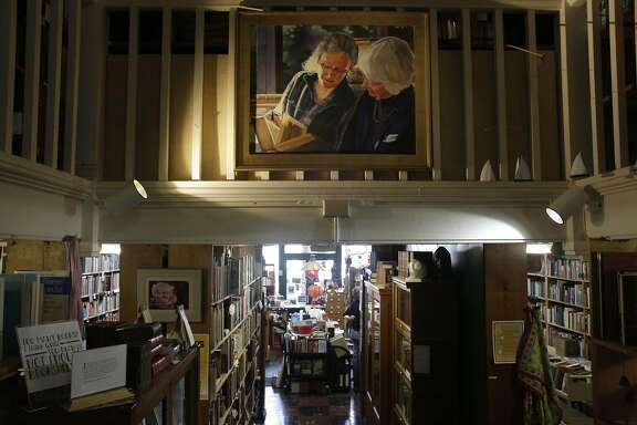 A painting of owner Faith Bell and her mother Valeria Bell, by Faith Bell's sister in law,  hangs at Bell's Books  on Tuesday, January 31, 2017 in Palo Alto, Calif.
